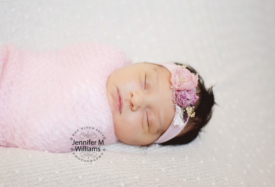 JMW Photography sleepy newborn girl.jpg